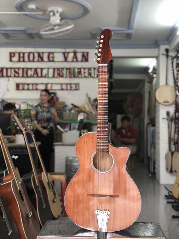 Đàn guitar thùng phím lõm chơi cải lương