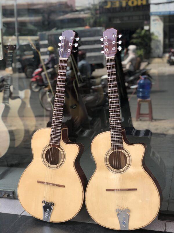Guitar cổ thùng phím lõm
